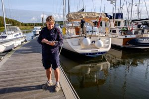Beaulieu River team member using a wifi enabled tablet in the marina