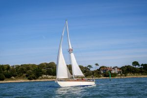 A boat navigates into the Beaulieu River