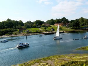Boats on Beaulieu River sail past Buckler's Hard, 3.5 Nm from the Solent