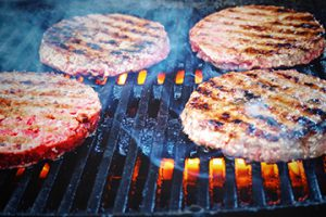 BBQ with burgers cooking
